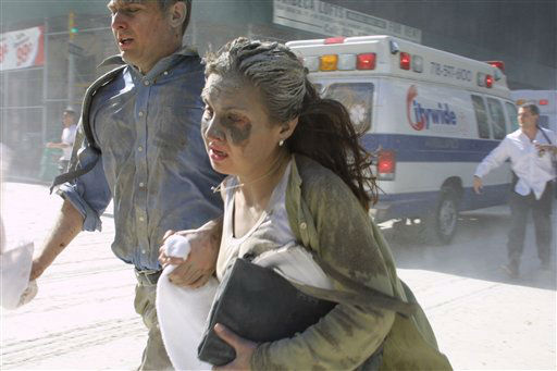 <div class='meta'><div class='origin-logo' data-origin='none'></div><span class='caption-text' data-credit='AP Photo/ Diane Bondareff'>People flee the scene near New York's World Trade Center after terrorists crashed two planes into the towers on Tuesday, September 11, 2001.</span></div>