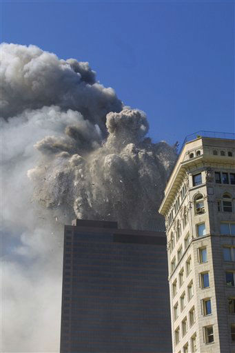 <div class='meta'><div class='origin-logo' data-origin='none'></div><span class='caption-text' data-credit='Photo/Diane Bondareff'>The north tower of the World Trade Center collapses on September 11, 2001 in New York City.</span></div>