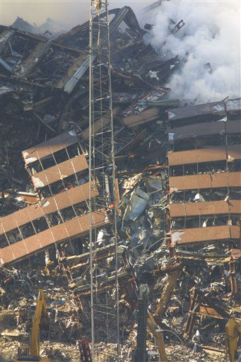 "<div class=""meta image-caption""><div class=""origin-logo origin-image ""><span></span></div><span class=""caption-text"">Construction workers continue to clear the rubble at the site of the World Trade Center, destroyed in the September 11, 2001 terrorist attacks, on September 15, 2001. (Photo/Wally Santana)</span></div>"