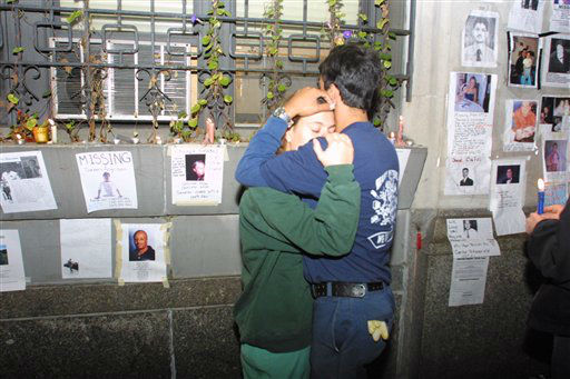 "<div class=""meta image-caption""><div class=""origin-logo origin-image none""><span>none</span></div><span class=""caption-text"">In this September 14, 2001 photograph, a man comforts a woman in front of missing person posters after the September 11 terrorist attacks. (AP Photo/ David Karp)</span></div>"