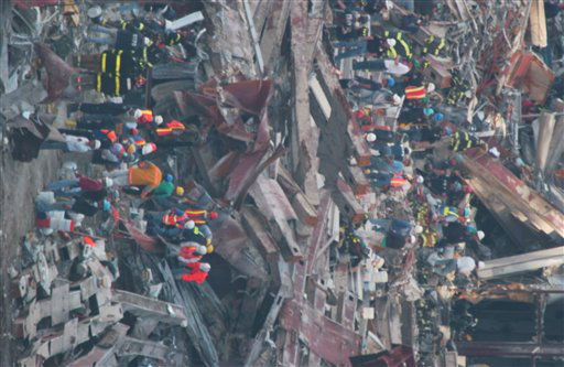 "<div class=""meta image-caption""><div class=""origin-logo origin-image none""><span>none</span></div><span class=""caption-text"">Construction workers continue to clear the rubble at the site of the World Trade Center, destroyed in the September 11, 2001 terrorist attacks, on September 15, 2001. (AP Photo/ Chad Rachman)</span></div>"