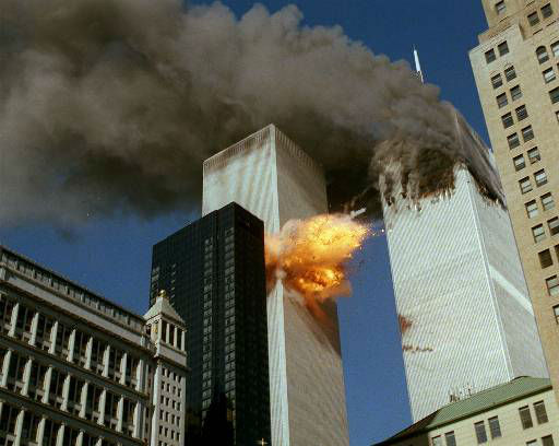 <div class='meta'><div class='origin-logo' data-origin='none'></div><span class='caption-text' data-credit='AP Photo/ CHAO SOI CHEONG'>Smoke pours off one of the towers of the World Trade Center as flames explode from the second one as it is struck by a plane Tuesday, Sept. 11, 2001.</span></div>