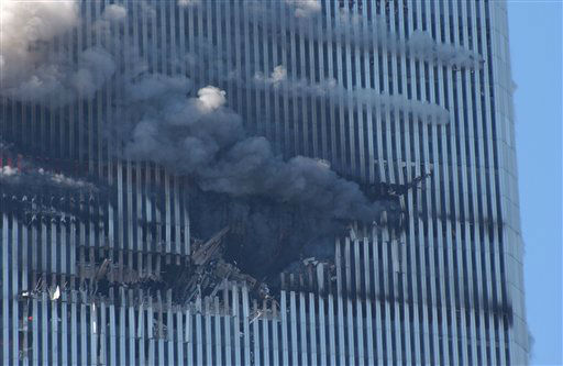 <div class='meta'><div class='origin-logo' data-origin='none'></div><span class='caption-text' data-credit='AP Photo/ Louis Lanzano'>The north tower of the World Trade Center's twin towers burns after a hijacked plane crashed into it on September 11, 2001 in New York City.</span></div>