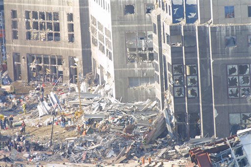 "<div class=""meta image-caption""><div class=""origin-logo origin-image none""><span>none</span></div><span class=""caption-text"">Workers clean up rubble on September 15, 2001 at ground zero after the September 11, 2001 attacks in New York City (AP Photo/ Wally Santana)</span></div>"