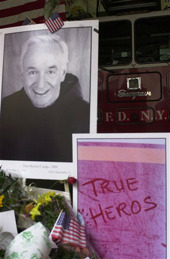 "<div class=""meta image-caption""><div class=""origin-logo origin-image ""><span></span></div><span class=""caption-text"">A large portrait of Father Mychael Judge, the FDNY chaplain who died in the World Trade Center collapse, is part of the memorial to firemen at Ladder 24, Engine 1 (Photo/Charlie Krupa)</span></div>"