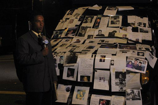 "<div class=""meta image-caption""><div class=""origin-logo origin-image none""><span>none</span></div><span class=""caption-text"">An ABC reporter in front of a car covered with posters of missing people from the September 11 terrorist attacks on the World Trade Center in NYC on Sept. 13, 2001. (AP Photo/ David Karp)</span></div>"