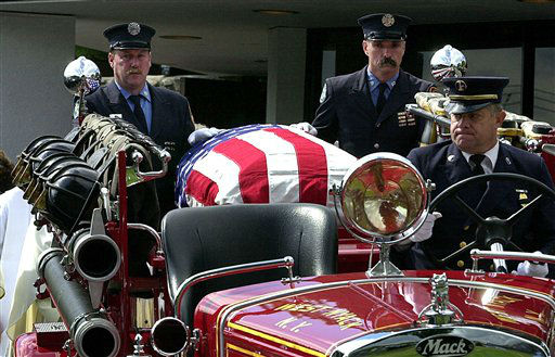 "<div class=""meta image-caption""><div class=""origin-logo origin-image none""><span>none</span></div><span class=""caption-text"">The casket for New York City firefighter Thomas Foley of West Nyack, N.Y., is carried from St. Anthony's Church in Nanuet, N.Y., to St. Anthony's cemetery. (AP Photo/ PETER CARR)</span></div>"
