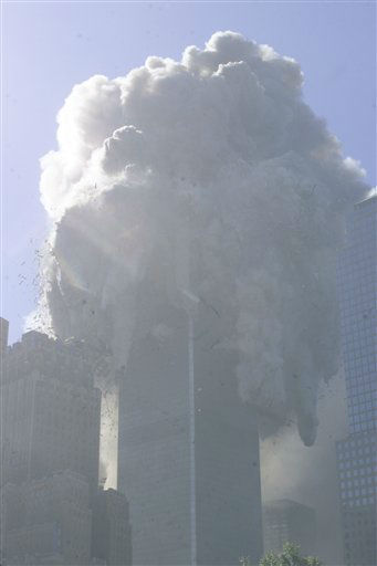 <div class='meta'><div class='origin-logo' data-origin='none'></div><span class='caption-text' data-credit='AP Photo/ Richard Drew'>The north tower of the World Trade Center collapses after a hijacked plane crashed into it on September 11, 2001 in New York City.</span></div>