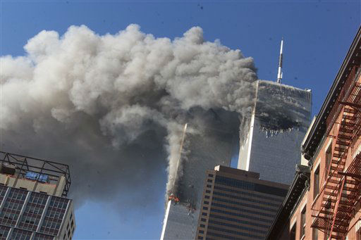 <div class='meta'><div class='origin-logo' data-origin='none'></div><span class='caption-text' data-credit='AP Photo/ Richard Drew'>Smoke rises from the burning twin towers of the World Trade Center after hijacked planes crashed into the towers on September 11, 2001 in New York City.</span></div>