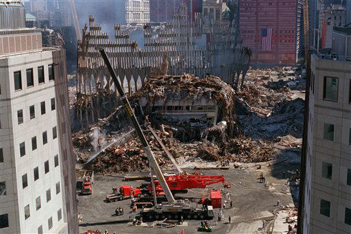 "<div class=""meta image-caption""><div class=""origin-logo origin-image none""><span>none</span></div><span class=""caption-text"">Two large cranes are positioned near the rubble of the World Trade Center in New York, on Wednesday, Sept. 26, 2001.  (AP Photo/ QUYEN TRAN)</span></div>"