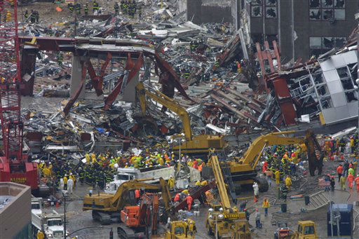 "<div class=""meta image-caption""><div class=""origin-logo origin-image none""><span>none</span></div><span class=""caption-text"">Construction workers and firemen continue to clear the rubble at the site of the World Trade Center, destroyed in the September 11, 2001 terrorist attacks, on September 14, 2001. (AP Photo/ Shawn Baldwin)</span></div>"
