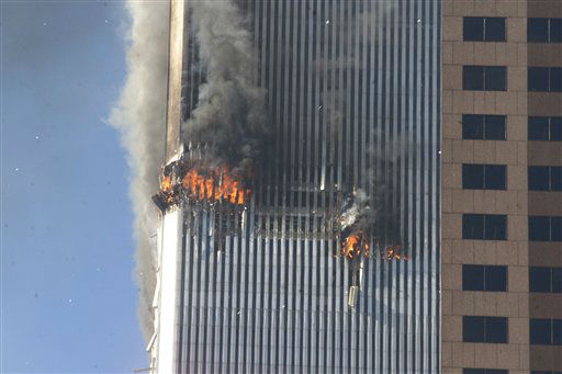 <div class='meta'><div class='origin-logo' data-origin='none'></div><span class='caption-text' data-credit='AP Photo/ Richard Drew'>Debris fall from one of the burning twin towers of the World Trade Center after a hijacked plane crashed into the tower on September 11, 2001 in New York City.</span></div>
