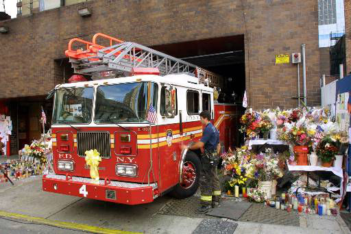 "<div class=""meta image-caption""><div class=""origin-logo origin-image none""><span>none</span></div><span class=""caption-text"">Ladder 4 truck is surrounded by makeshift memorials as it returns to its midtown New York firehouse after a call Tuesday, Sept. 18, 2001. (AP Photo/ STUART RAMSON)</span></div>"