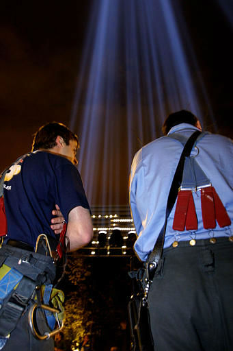 "<div class=""meta image-caption""><div class=""origin-logo origin-image none""><span>none</span></div><span class=""caption-text"">New York Firefighters Tim Hallahan, left, and Lt. Peter White look at ""Tribute in Light,"" Saturday, April 13, 2002. (AP Photo/ JOHN-MARSHALL MANTEL)</span></div>"