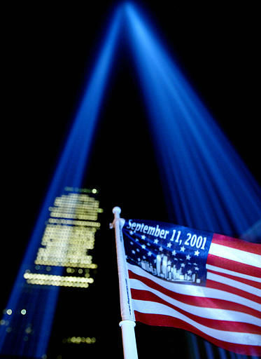 "<div class=""meta image-caption""><div class=""origin-logo origin-image none""><span>none</span></div><span class=""caption-text"">The Tribute in Light rises near Ground Zero on Sept. 12, 2003. The twin beams of light were switched on at sunset, evoking the image of the twin towers. (AP Photo/ JOHN MARSHALL MANTEL)</span></div>"