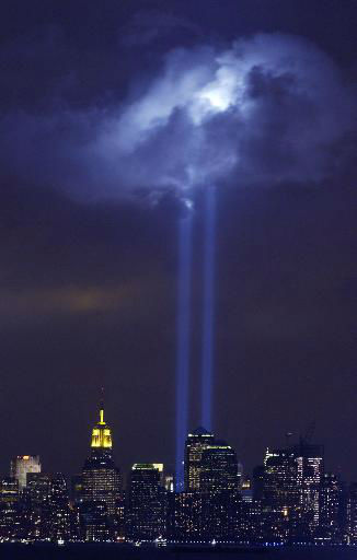 "<div class=""meta image-caption""><div class=""origin-logo origin-image none""><span>none</span></div><span class=""caption-text"">A test of the Tribute in Light memorial illuminates a passing cloud above lower Manhattan Thursday, Sept. 9, 2004, in New York. (AP Photo/ MIKE HVOZDA)</span></div>"
