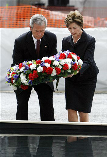 """<div class=""""meta image-caption""""><div class=""""origin-logo origin-image none""""><span>none</span></div><span class=""""caption-text"""">President Bush and first lady Laura Bush lay a memorial wreath in a pool of water at ground zero Sunday, Sept. 10, 2006, marking the 5th anniversary. (AP Photo/ SETH WENIG)</span></div>"""