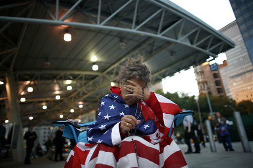 "<div class=""meta image-caption""><div class=""origin-logo origin-image none""><span>none</span></div><span class=""caption-text"">Delia Colon, of Hamilton Square, bows her head as she prays at Ground Zero near the end of an all-night vigil on the fifth anniversary in 2006. (AP Photo/ JASON DECROW)</span></div>"