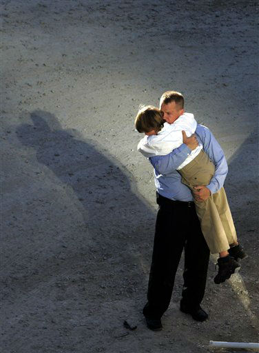 """<div class=""""meta image-caption""""><div class=""""origin-logo origin-image none""""><span>none</span></div><span class=""""caption-text"""">A man embraces a young boy during a ceremony Monday, Sept. 11, 2006 at the World Trade Center in New York marking the fifth anniversary of the terrorist attacks. (AP Photo/ MIKE SEGAR)</span></div>"""