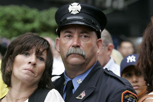 """<div class=""""meta image-caption""""><div class=""""origin-logo origin-image none""""><span>none</span></div><span class=""""caption-text"""">Robin Ferreira and James Sorokac, with the FDNY, join other mourners during a commemoration ceremony on Tuesday, Sept. 11, 2007 on the sixth anniversary. (AP Photo/ Frank Franklin II)</span></div>"""