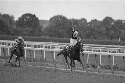 "<div class=""meta image-caption""><div class=""origin-logo origin-image none""><span>none</span></div><span class=""caption-text"">Jean Cruguet is up in the saddle as he rides Seattle Slew to the finish at the Belmont, June 11, 1977, after winning the Kentucky Derby and Preakness. (AP Photo/Richard Drew) (AP Photo/ Richard Drew)</span></div>"