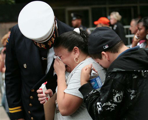 "<div class=""meta image-caption""><div class=""origin-logo origin-image none""><span>none</span></div><span class=""caption-text"">Ina Castro and son Jonathan Rivera cry during a ceremony on the seventh anniversary in 2008. Jose Castro, Ms. Castro's brother, was a waiter at Windows on the World. (AP Photo/ James Estrin)</span></div>"