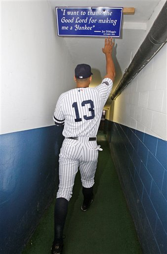 <div class='meta'><div class='origin-logo' data-origin='AP'></div><span class='caption-text' data-credit='ASSOCIATED PRESS'>** FILE **In this Wednesday, Sept. 17, 2008, file photo, New York Yankees slugger Alex Rodriguez touches a sign that hangs over the tunnel to the field at Yankee Stadium.</span></div>