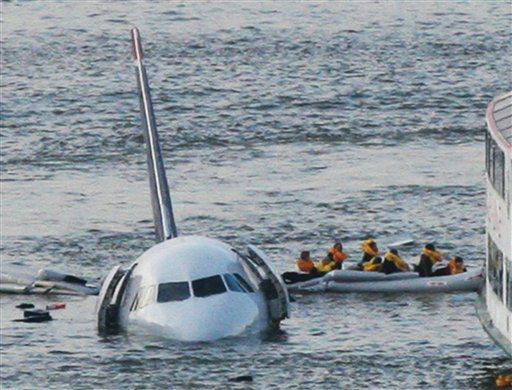 <div class='meta'><div class='origin-logo' data-origin='none'></div><span class='caption-text' data-credit='AP Photo/ Bebeto Matthews'>Passengers in an inflatable raft move away from an Airbus 320 US Airways aircraft that has gone down in the Hudson River in New York.</span></div>