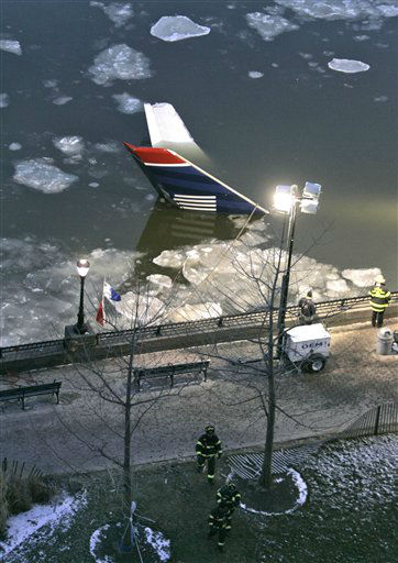 "<div class=""meta image-caption""><div class=""origin-logo origin-image none""><span>none</span></div><span class=""caption-text"">An Airbus 320 US Airways aircraft that crashed into the Hudson River  was towed to the west side of Manhattan for further inspection. (AP Photo/ Frank Franklin II)</span></div>"