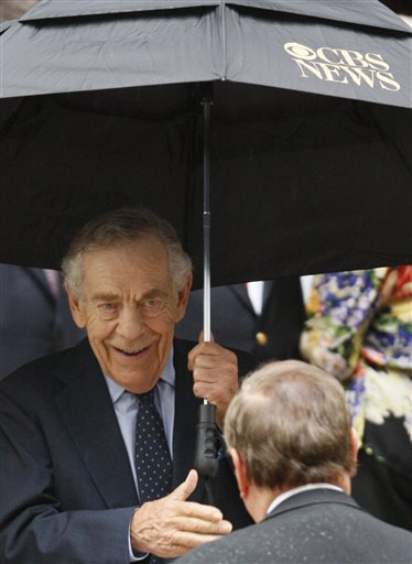 <div class='meta'><div class='origin-logo' data-origin='AP'></div><span class='caption-text' data-credit='AP Photo/Kathy Willens'>CBS 60 Minutes correspondent Morley Safer leaves the funeral for CBS anchorman Walter Cronkite at St. Bartholomew's Church Thursday, July 23, 2009 in New York.</span></div>