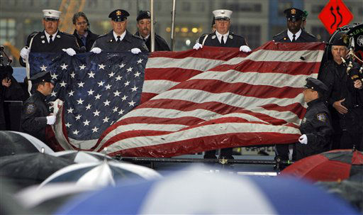 """<div class=""""meta image-caption""""><div class=""""origin-logo origin-image none""""><span>none</span></div><span class=""""caption-text"""">The World Trade Center flag is folded after being presented at the commemoration ceremony on the eighth anniversary in 2009. (AP Photo/ Jason DeCrow)</span></div>"""