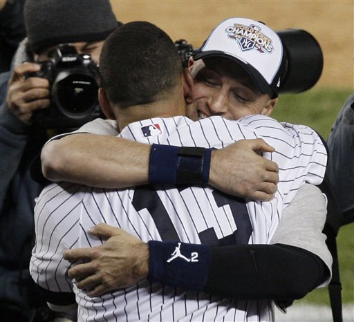 "<div class=""meta image-caption""><div class=""origin-logo origin-image ap""><span>AP</span></div><span class=""caption-text"">New York Yankees Derek Jeter, right, hugs Alex Rodriguez after winning the Major League Baseball World Series against the Philadelphia Phillies Wednesday, Nov. 4, 2009. (AP)</span></div>"