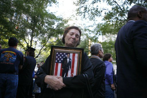 "<div class=""meta image-caption""><div class=""origin-logo origin-image none""><span>none</span></div><span class=""caption-text"">Anna Sereno, of the Brooklyn, holds a photo of her son Arturo Angelo Sereno on the ninth anniversary of the terrorist attacks on the World Trade Center, Saturday, Sept. 11, 2010. (AP Photo/ Jason DeCrow)</span></div>"