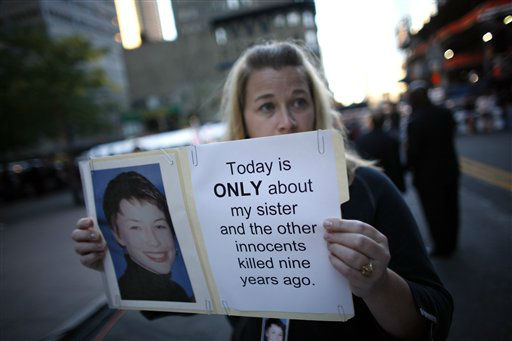 """<div class=""""meta image-caption""""><div class=""""origin-logo origin-image none""""><span>none</span></div><span class=""""caption-text"""">Alyson Low, of Fayetteville, Ark., holds a photo of her sister Sara Low on the ninth anniversary of the terrorist attacks on the World Trade Center, Saturday, Sept. 11, 2010. (AP Photo/ Jason DeCrow)</span></div>"""