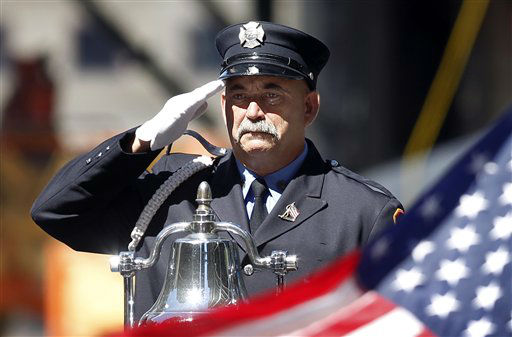 """<div class=""""meta image-caption""""><div class=""""origin-logo origin-image none""""><span>none</span></div><span class=""""caption-text"""">A firefighter salutes as taps is played, before a moment of silence on the ninth anniversary of the terrorist attacks in 2010. (AP Photo/ Jason DeCrow)</span></div>"""