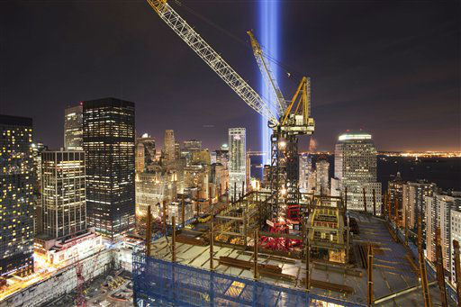 "<div class=""meta image-caption""><div class=""origin-logo origin-image none""><span>none</span></div><span class=""caption-text"">The Tribute in Light rises above the construction cranes on One World Trade Center, and the lower New York skyline, Saturday, Sept. 11, 2010.. (AP Photo/ Mark Lennihan)</span></div>"