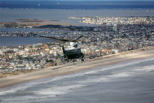 <div class='meta'><div class='origin-logo' data-origin='none'></div><span class='caption-text' data-credit='AP Photo/ Doug Mills'>Marine One, carrying President Barack Obama and New Jersey Gov. Chris Christie, takes an aerial tour of the Atlantic Coast in New Jersey in areas damaged by Superstorm Sandy.</span></div>