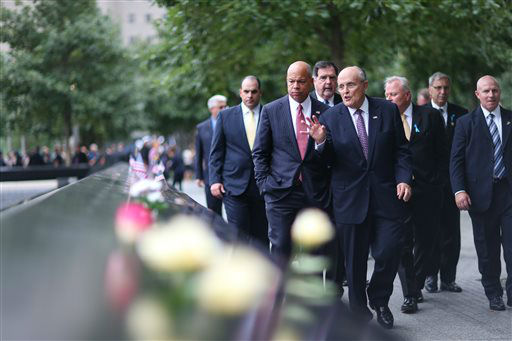 "<div class=""meta image-caption""><div class=""origin-logo origin-image none""><span>none</span></div><span class=""caption-text"">Former New York City Mayor Rudy Giuliani visits the South Tower Memorial during memorial observances on the 13th anniversary of the Sept. 11 terror attacks. (AP Photo/ Chang W. Lee)</span></div>"