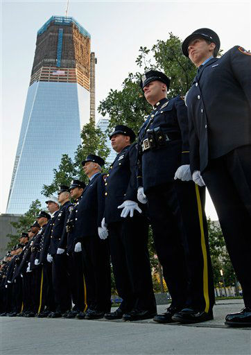 """<div class=""""meta image-caption""""><div class=""""origin-logo origin-image none""""><span>none</span></div><span class=""""caption-text"""">NYPD, FDNY and PAPD line up at one of the entrances to 9/11 Memorial Plaza at the World Trade Center site before the 10th anniversary ceremony in 2011. (AP Photo/ Chip Somodevilla)</span></div>"""
