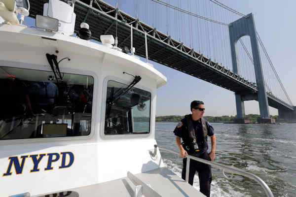 "<div class=""meta image-caption""><div class=""origin-logo origin-image none""><span>none</span></div><span class=""caption-text"">Lt. John Smerina, of the NYPD Harbor Unit, patrols on the first day of Fleet Week aboard the Dillon Stewart as she passes under the Verrazano-Narrows Bridge. (AP Photo/Richard Drew)</span></div>"