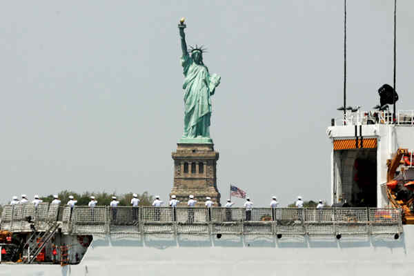 "<div class=""meta image-caption""><div class=""origin-logo origin-image none""><span>none</span></div><span class=""caption-text"">The crew of the US Coast Guard Cutter Forward, from Portsmouth, Va., salutes as they pass the Statue of Liberty in New York, Wednesday, May 25, 2016. (AP Photo/Richard Drew)</span></div>"