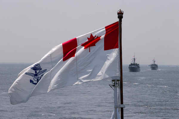 "<div class=""meta image-caption""><div class=""origin-logo origin-image none""><span>none</span></div><span class=""caption-text"">The Royal Canadian Navy Ensign flies on the HMCS Kingston and HMCS Moncton sail behind during the Parade of Ships entering the New York Harbor, Wednesday, May 25, 2016. (AP Photo/Mary Altaffer)</span></div>"