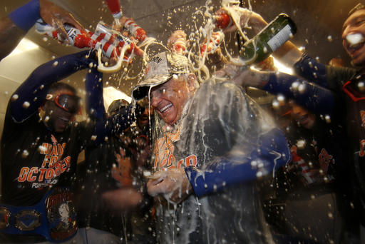 <div class='meta'><div class='origin-logo' data-origin='AP'></div><span class='caption-text' data-credit='AP'>New York Mets manager Terry Colllins is doused with champagne and beer in the clubhouse after the Mets secured a wild card playoff spot.</span></div>