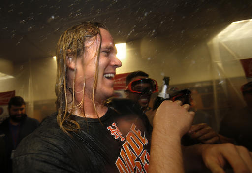 <div class='meta'><div class='origin-logo' data-origin='AP'></div><span class='caption-text' data-credit='AP'>New York Mets pitcher Noah Syndergaard is doused with champaign in the clubhouse after the Mets secured a wild card playoff spot.</span></div>