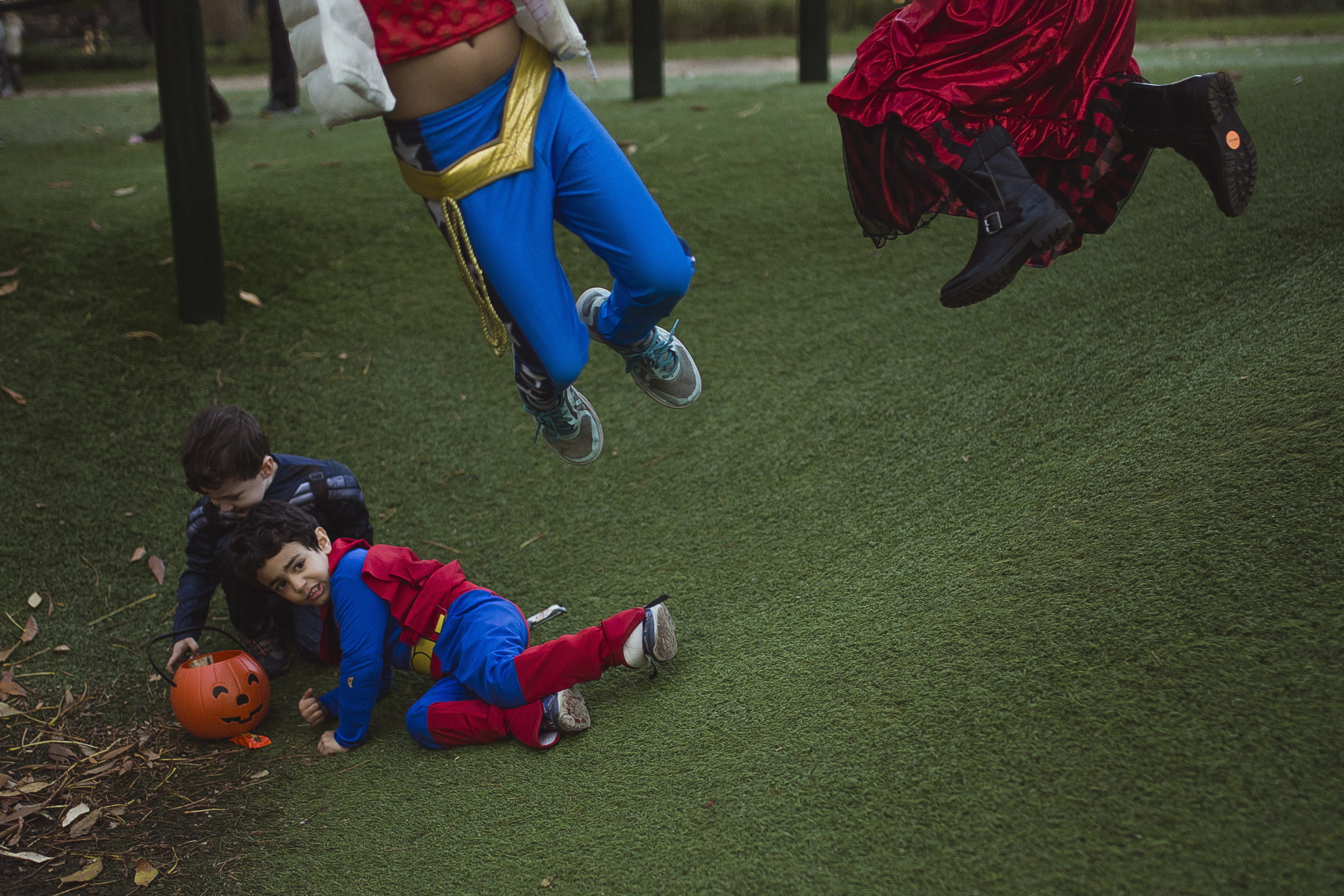 """<div class=""""meta image-caption""""><div class=""""origin-logo origin-image none""""><span>none</span></div><span class=""""caption-text"""">Children wearing costumes play at Washington Square Park before the Greenwich Village Halloween Parade in New York, Monday, Oct. 31, 2016. (AP Photo/Andres Kudacki)</span></div>"""
