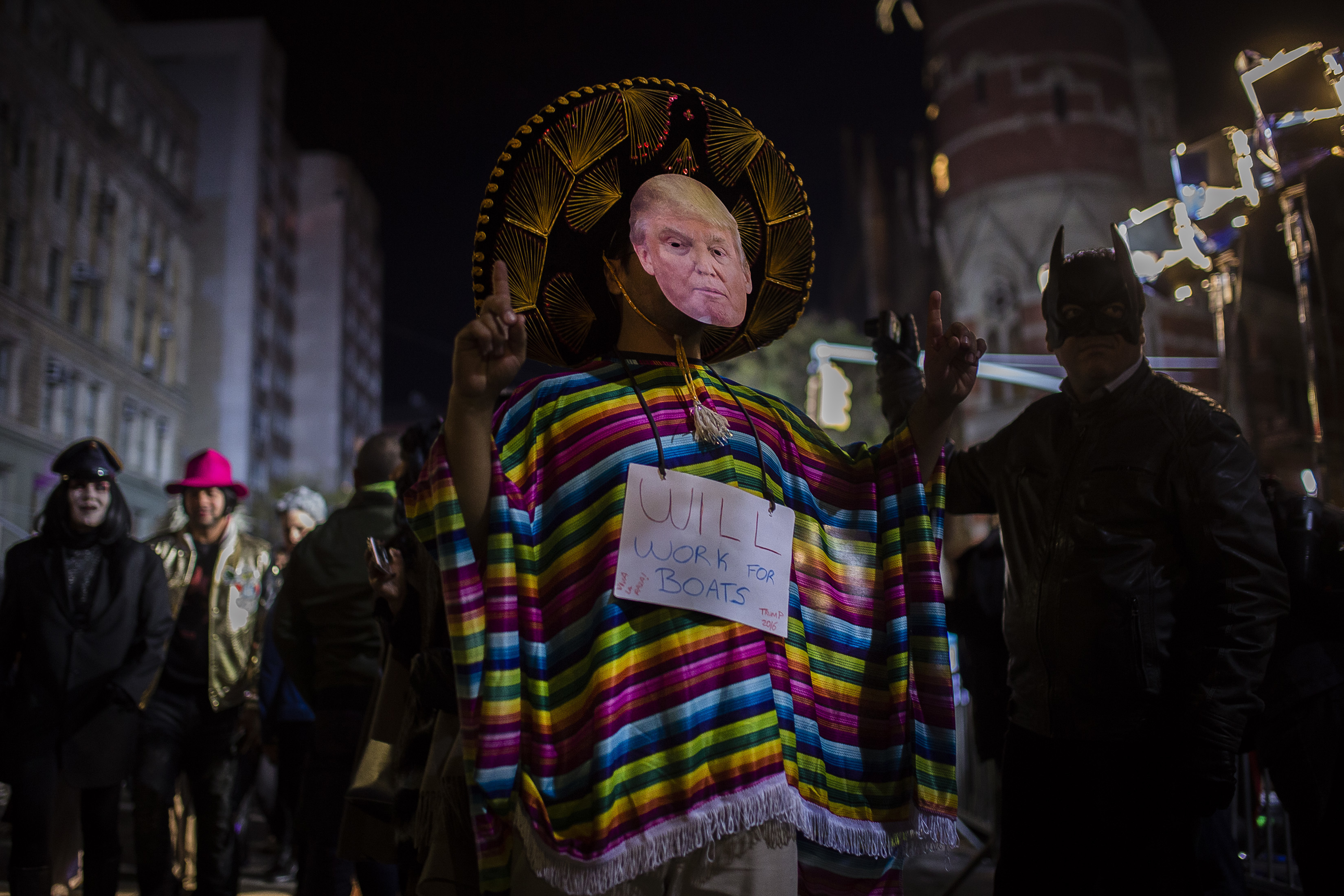 """<div class=""""meta image-caption""""><div class=""""origin-logo origin-image none""""><span>none</span></div><span class=""""caption-text"""">A reveler wearing a Donald Trump mask marches during the Greenwich Village Halloween Parade in New York, Monday, Oct. 31, 2016. (AP Photo/Andres Kudacki)</span></div>"""