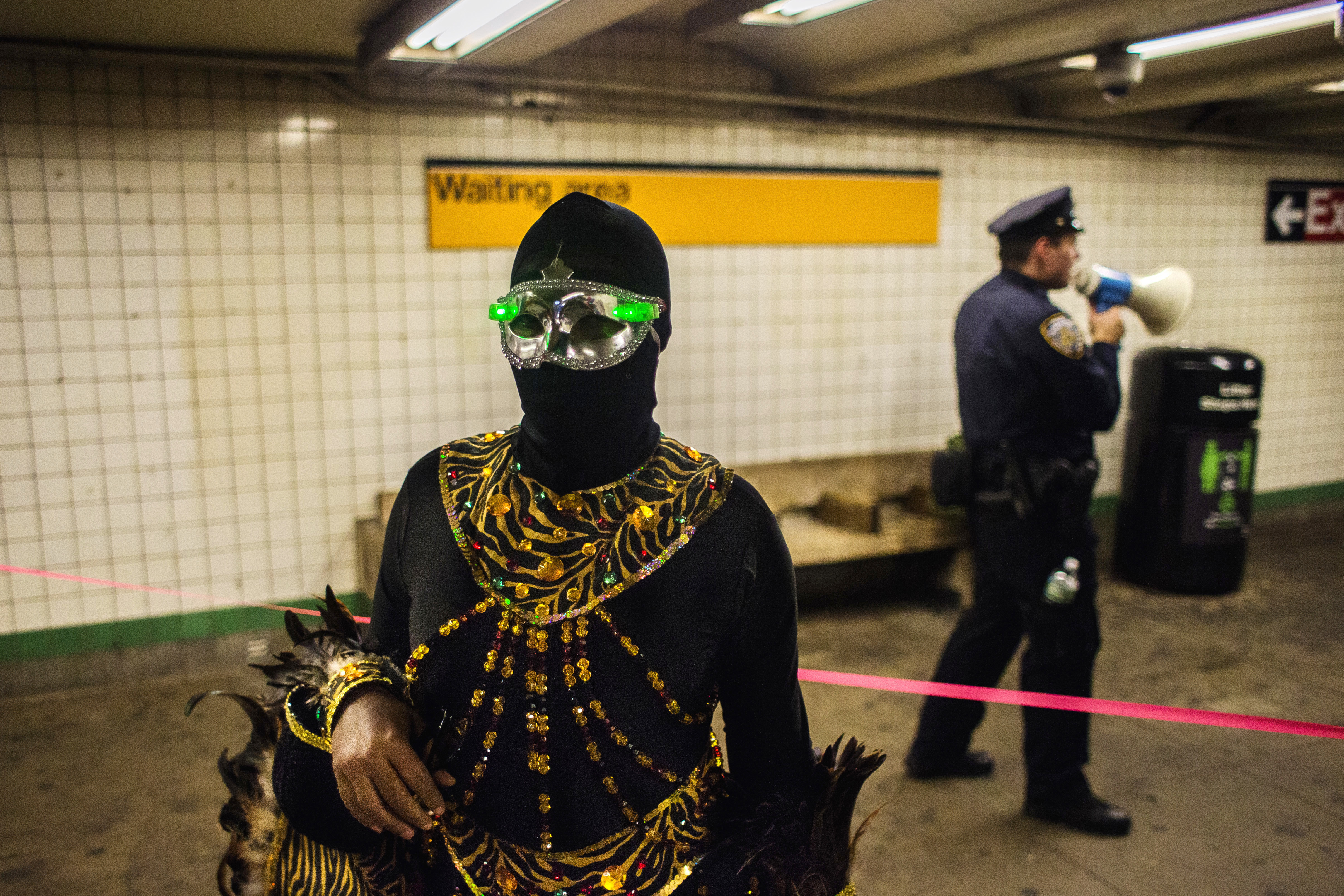 """<div class=""""meta image-caption""""><div class=""""origin-logo origin-image none""""><span>none</span></div><span class=""""caption-text"""">A reveler stands inside the subway station as a police officer speaks into a megaphone after the Greenwich Village Halloween Parade in New York, Monday, Oct. 31, 2016. (AP Photo/Andres Kudacki)</span></div>"""