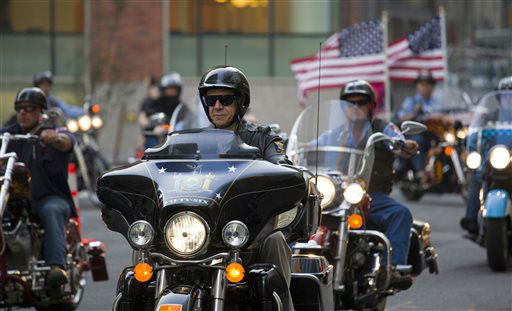 "<div class=""meta image-caption""><div class=""origin-logo origin-image none""><span>none</span></div><span class=""caption-text"">New York Gov. Andrew Cuomo rides with firefighters and first responders with the FDNY Motorcycle Club Wednesday, Sept. 11, 2013. (AP Photo/ Craig Ruttle)</span></div>"