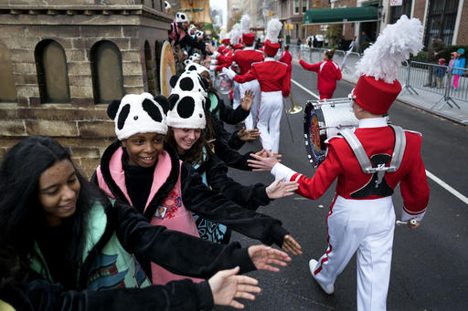 "<div class=""meta image-caption""><div class=""origin-logo origin-image none""><span>none</span></div><span class=""caption-text"">Participants greet others as they await the start of the Macy's Thanksgiving Day Parade in New York, Thursday, Nov. 24, 2016. (AP Photo/Craig Ruttle)</span></div>"