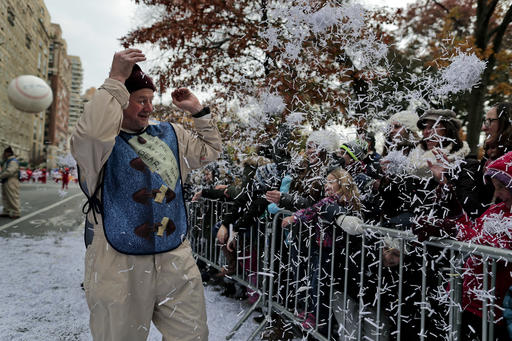 "<div class=""meta image-caption""><div class=""origin-logo origin-image none""><span>none</span></div><span class=""caption-text"">Spectators shower a ballon operator with shredded paper during the Macy's Thanksgiving Day parade, Thursday, Nov. 24, 2016, in New York. (AP Photo/Julie Jacobson)</span></div>"